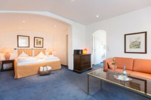 Doppelzimmer Deluxe Schlaf u. Wohnraum